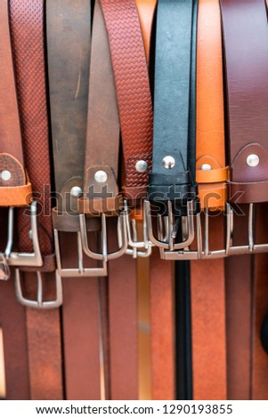 Close up shoot of some belts in a store. Store is located in hoi an in vietnam. Big leather culture in this town. High quality leather work for cheap prices