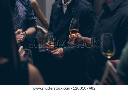 Close up shot group of people in corporate business dinner event with food and champagne