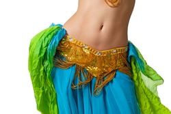 Close up shot of a belly dancer wearing a blue, gold and green costume shaking her hips. Isolated on white. Clipping path included so image can be easily transferred to a different colored background.
