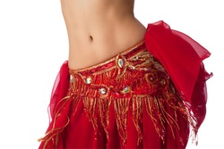 Close up shot of a belly dancer wearing a red costume shaking her hips. Isolated on white. Clipping path included.