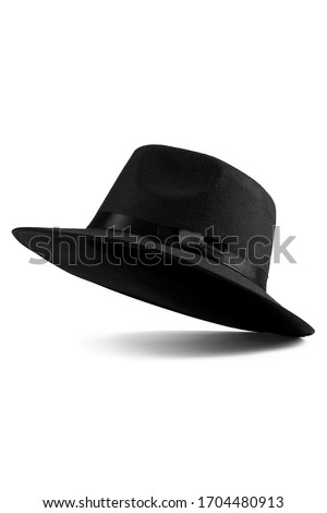 Close up shot of a black fedora hat with the black silk ribbon and a bow around a crown. The classic hat is isolated on the white backdrop.  Stock photo ©