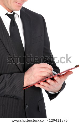 Close-up shot of a business man with clipboard and pen.