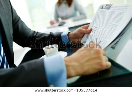 Close-up shot of a businessman reading the latest news - stock photo