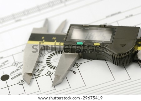 Close up shot of a calliper on Engineering drawing background - stock photo