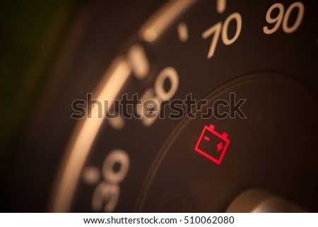 Close up shot of a car's dashboard with the battery icon lit. #510062080