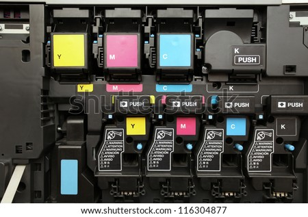 close-up shot of a CMYK ink cartridges for laser copier machine