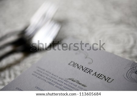 Close up shot of a dinner menu on a table