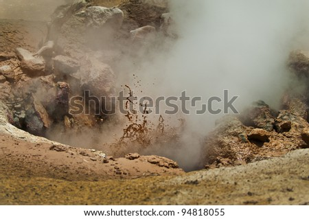Close-up shot of a erupting mud volcano in yellowstone - stock photo