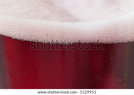 Close up shot of a glass of cherry fruit beer