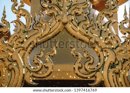 Close-up Shot of a Gold Gate at a Thai Temple
