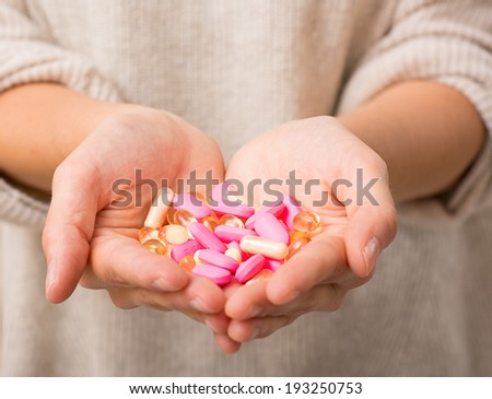 Close-up shot of a hand holding pills