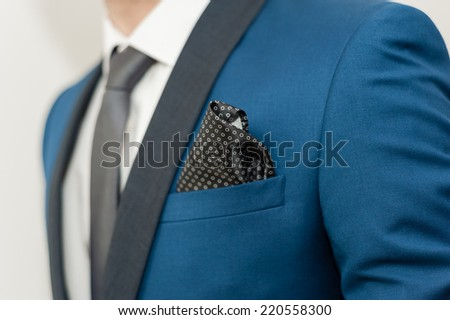 Close-up shot of a man dressed in formal wear .Groom\'s suit