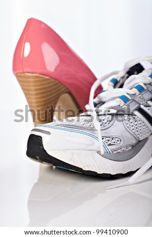 Close up shot of a pair of high heels shoes and runners
