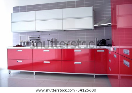 close up shot of a red modern kitchen with cabinet and drawers