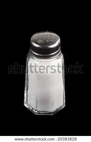 Close-up shot of a salt shaker on black background