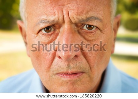 Close up shot of a scared and worried senior emotion