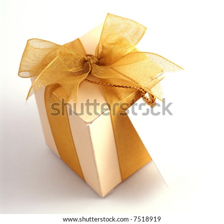 Close-up shot of a small box of appreciation gift with a blank note. Selective focus is intentional.