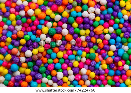 CLOSE UP SHOT OF A VERY SMALL COLORFUL CANDIES USED FOR CAKES DECORATIONS