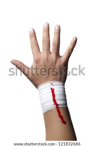 Close-up shot of a white bandage on a human hand with blood on it.