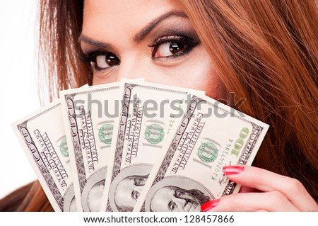 Close up shot of a woman holding a fan of hundred-dollar bills