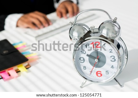 Close-up shot of an alarm-clock in business environment