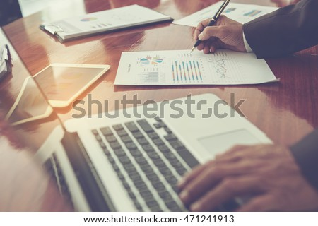 Close-up shot of an analytical working with the latest financial results Financial accounting sales forecast graphs analysis with hand writing , digital effect abstract for background #471241913