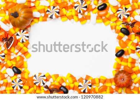 Close-up shot of arranged candy corns and pumpkins. #120970882