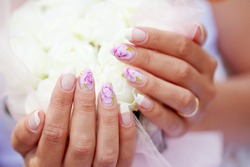 Close-up shot of art bridal manicure with painted nails