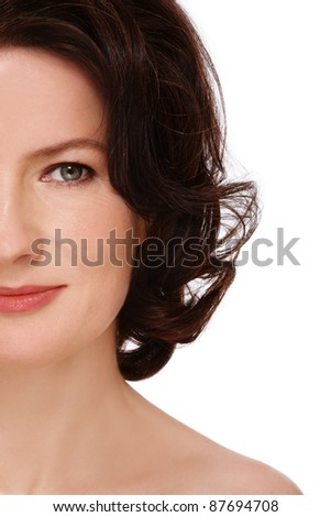 Close-up shot of attractive groomed healthy middle-aged woman on white background