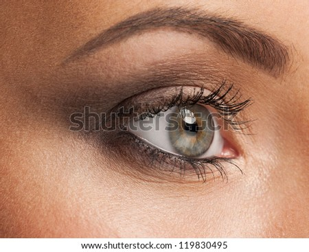 Close-up shot of beautiful female eye with bright fashion makeup - stock photo