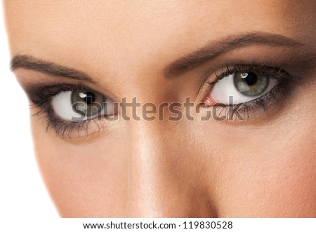 Close-up shot of beautiful female eyes with bright fashion makeup