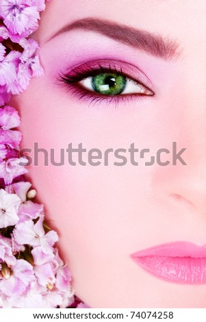 Close-up shot of beautiful woman's face with bright makeup
