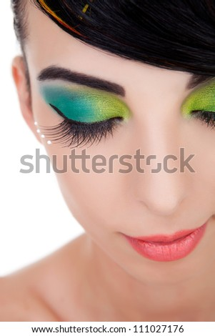 Close-up shot of beautiful woman with bright stylish make-up with closed eyes