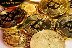 Close up shot of Bitcoins coins isolated on motherboard background. Crypto currency, bitcoin. BTC, Bit Coin. Blockchain technology, bitcoin mining.