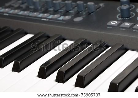 Close up shot of black & white piano keys - stock photo