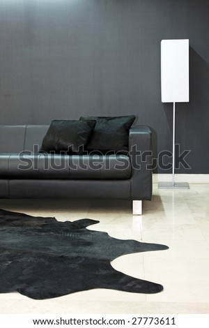 Close up shot of black leather sofa part