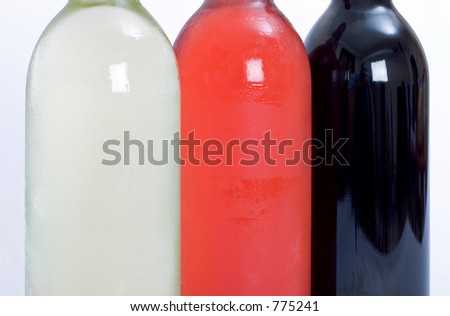 Close up shot of bottles of red, white and rose wine