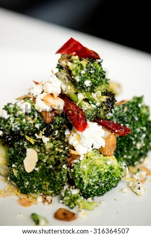 close up shot of broccoli salad with feta cheese