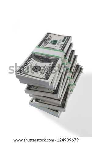 Close-up shot of bundles of US dollars on plain white background.