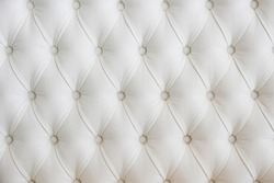Close up shot of buttoned eco leather headboard of the bed. Copy space, background.