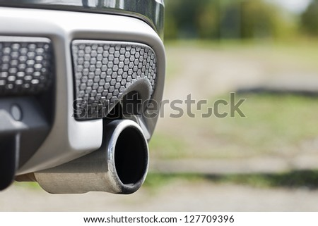 Close up shot of car exhaust pipe