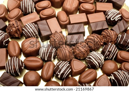 close up shot of chocolates on white background