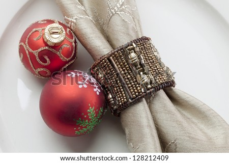 Close-up shot of Christmas bauble with napkin on plate