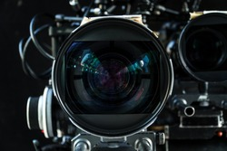 Close up shot of cinema lens with lot of equipment for filming cinema or movie in a division filming. Cinema lens. Photo lens.
