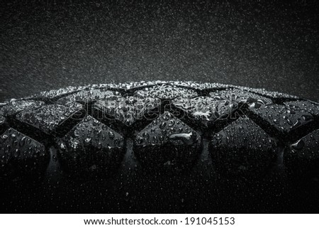 Close-up shot of classical motorcycle tire tread in wet weather condition  #191045153