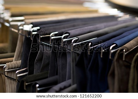 Close-up shot of clothes on hanger.