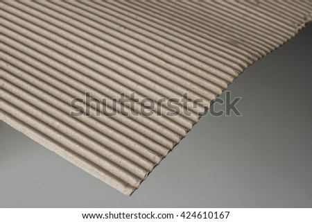 close up shot of corrugated cardboard on white background #424610167