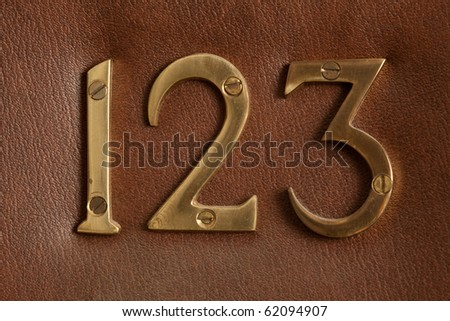 Close up shot of door with numerals 123.
