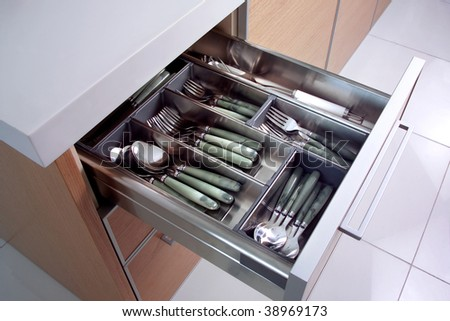 close up shot of drawer with spoons and forks