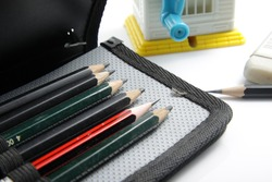 Close up shot of drawing supplies that contains pencils, eraser and pencil sharperner